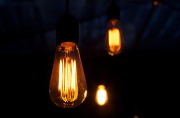 An image of four spiral light bulbs.