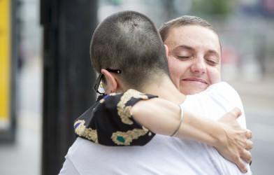 Two women hugging.