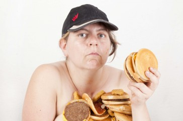 Katy Baird is centre photo, covered in hand burgers.