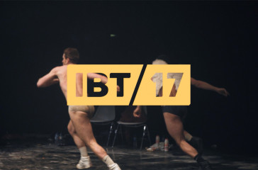 Two men about to leap on stage. With IBT17 logo.