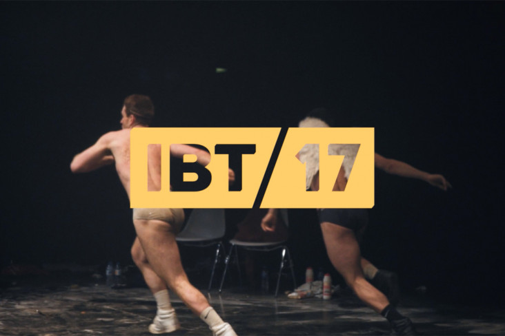 Featured News Post Two men about to leap on stage. With IBT17 logo.