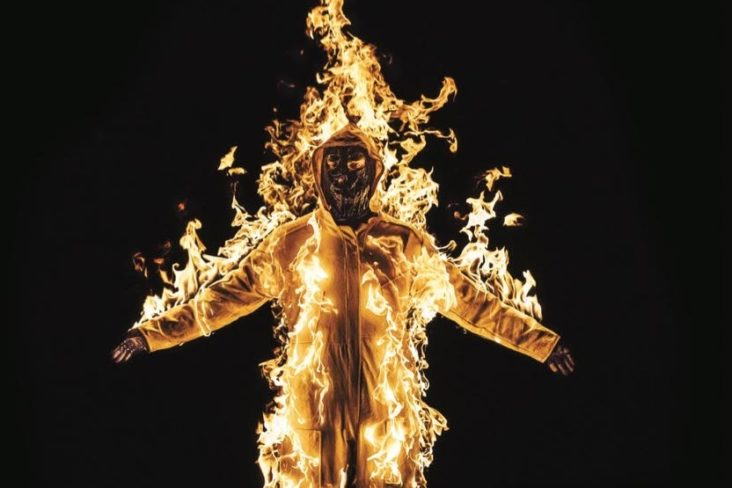 It's Time book cover with a man wearing burning suit.