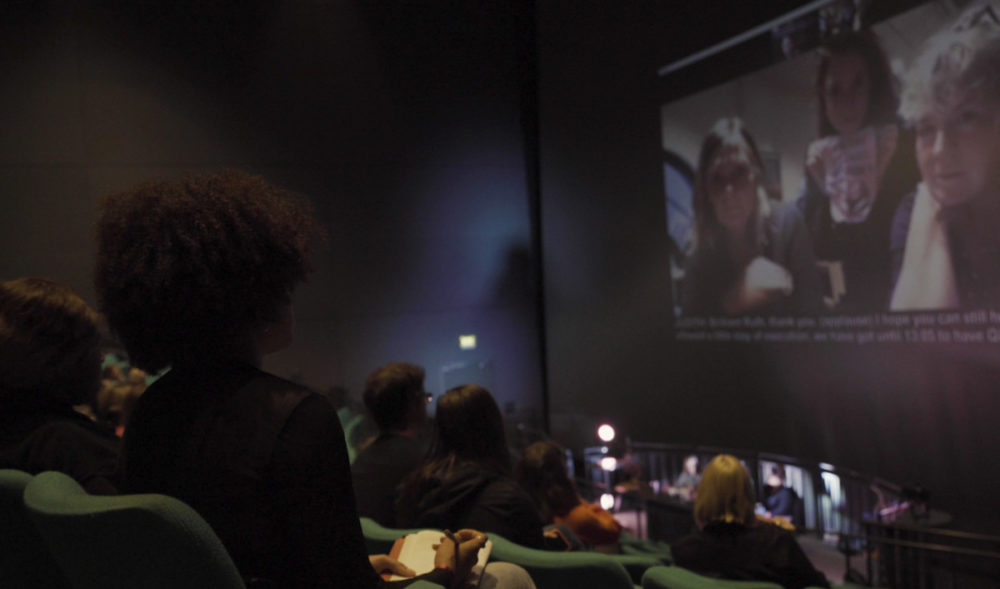 An audience look at a cinema screen