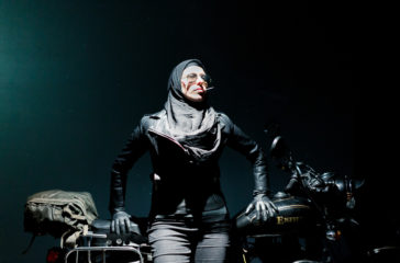 Artist Cigdem Aydemir seated on a motorbike