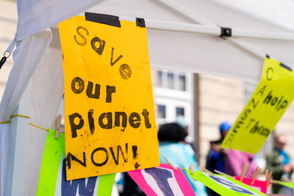 Poster reads 'Save Our Planet Now!'